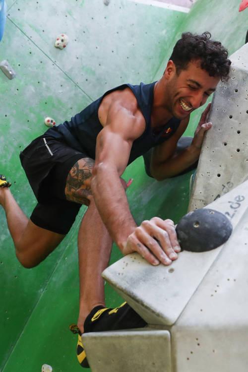 Daniel Ricciardo tries bouldering