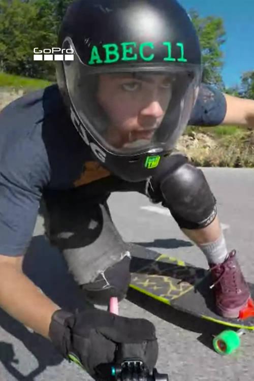 Downhill skateboard ride-along